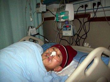 Лэй Чженся после избиения полицейскими попал в больницу. Фото с minghui.org