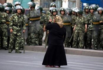 Город Урумчи. 7 июля. Фото: AP Photo/Ng Han Guan