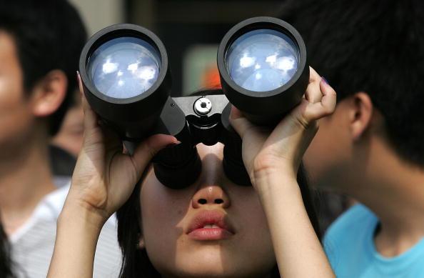 Жители Азии наблюдали солнечное затмение. Южная Корея, Сеул. 22 июля 2009р. Фото: Chung Sung-Jun/Getty Images