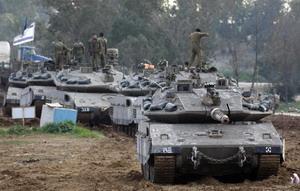 Израиль завершает подготовку к третьему этапу антитеррористической операции в секторе Газа. Фото: JACK GUEZ/AFP/Getty Images