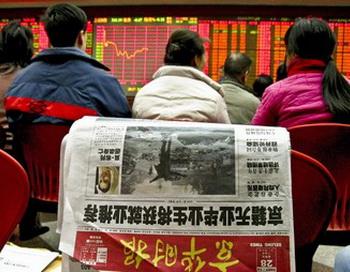 Китай продолжает надувать пузыри на своем фондовом рынке. Фото: TEH ENG KOON/AFP/Getty Images