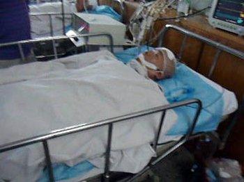 Го Хуэйшень находится в коме после избиения в полицейском участке. Фото с minghui.org