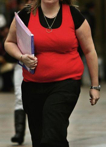 Ожирение может быть связано со стрессом. Фото: Photos.com