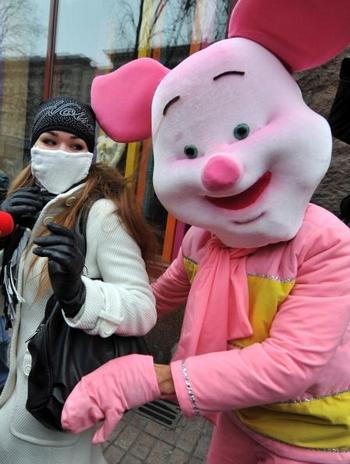 Свиной грипп – лучшая реклама марлевых повязок и антивирусных препаратов Фото: SERGEI SUPINSKY/AFP/Getty Images
