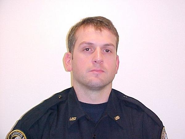 Полицейский Лейквуда сержант Марк Реннинджер (Mark Renninger), который был убит 29 ноября 2009 наряду с тремя другими Лейквудскими полицейскими. Фото: Stephen Brashear/Getty Images