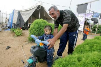 Лагерь беженцев в Ататре. Фото: YASSER SAYMEH/AFP/Getty Images