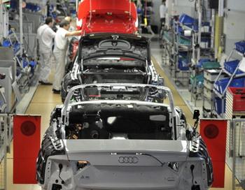 Audi начнет выпускать модели А3, А4, Q7 с гибридными установками в 2014 году. ФОТО:GETTY.