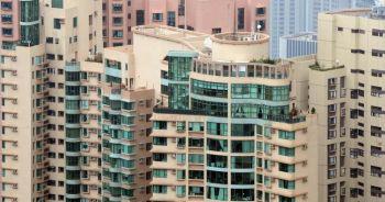 На этой фотографии видны верхние этажи нескольких роскошных апартаментов в Гонконге. Гонконгский рынок роскошных кооперативных квартир испытал недавнее оживление продаж. (Фото Laurent Fievet/AFP/Getty Images)