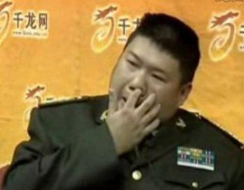 Мао Синью.