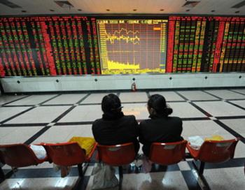 По словам Алана Гринспана, экономическое благосостояние Китая - «нерациональное преувеличение». Foto: STR/AFP/Getty Images