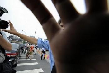 Из-за сообщений на чувствительные темы журналисты в Китае могут легко стать объектом нападок правительства и частных компаний. Фото: Getty Images
