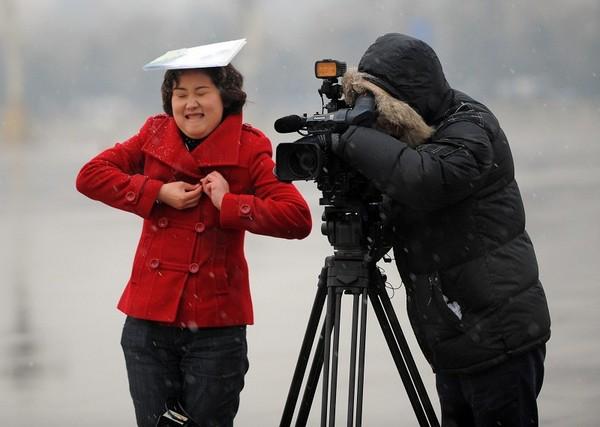 Снегопад в Пекине. 14 марта 2010 год. Фото: AFP PHOTO/ LIU Jin