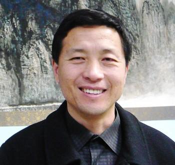 Адвокат Тан Цзитянь, которого лишили адвокатской лицензии за защиту последователей Фалуньгун. Фото с epochtimes.com