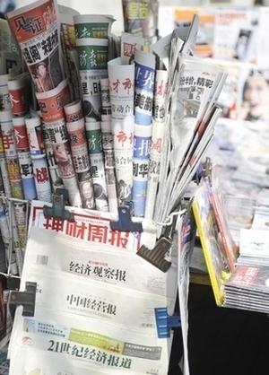 Китайские СМИ вынуждены сообщать только те новости, которые разрешает компартия. Фото: AFP