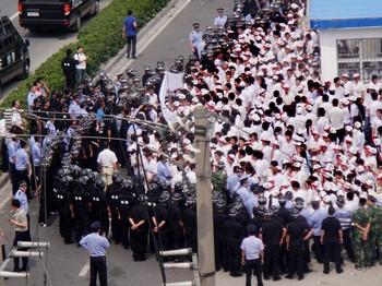 Китайские власти стараются умалить влияние забастовок рабочих. Фото: Getty Images