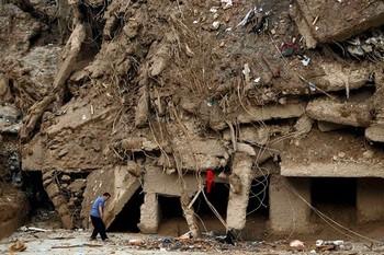 Число геологических бедствий в Китае увеличилось в 10 раз. Оползень накрыл здание в провинции Ганьсу. Фото с epochtimes.com