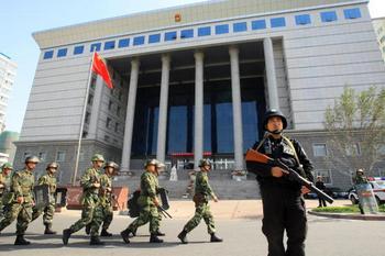 В СУРЕ продолжают выносить смертные приговоры уйгурам. Фото: STR/AFP/Getty Images