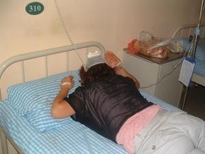 На фото покалеченная крестьянка Ли Шуминь. Фото с epochtimes.com