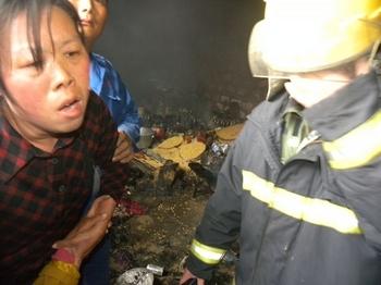 Жертвы насильственного сноса усадьб. Уезд Гуаньюнь провинции Цзянсу. 13 мая 2011 год. Фото предоставили местные жители