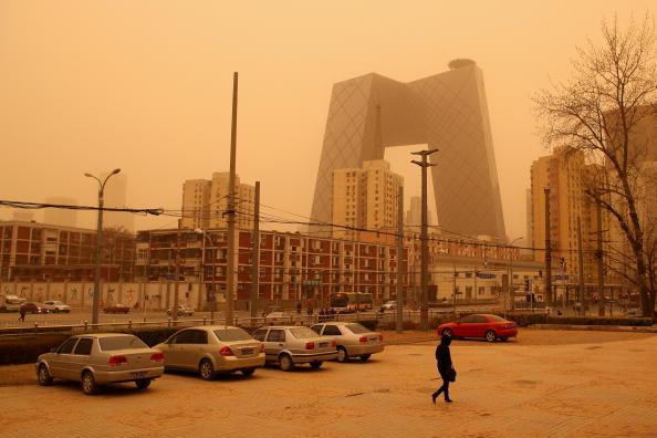 Песчаная буря бушует в Пекине. Фоторепортаж. Фото:  Feng Li/Getty Images