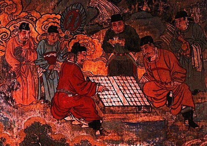 Мужчины увлеченно играют в «Сянци», древнюю игру в шахматы. Фото: Zhongguo Meishu Quanji