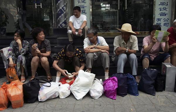 Китайские зарисовки. Китайцы дома и на работе. Фото: China Photos/Getty Images