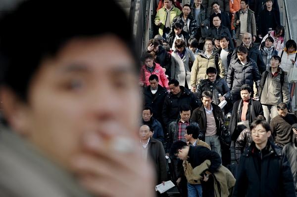 Китайские зарисовки. Китайцы дома и на работе. Фото: PHILIPPE LOPEZ/AFP/Getty Images)