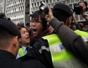 Арест журналистов в Китае. Фото: Ed JONES/AFP/Getty Images
