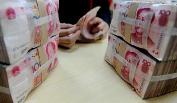 В октябре 2011 г. Китай столкнулся с первым снижением фондов, выделяемых для обмена иностранной валюты. Фото EPA