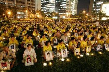 Акция со свечами в память погибших от репрессий учеников Фалуньгун. Тайвань. Фото: minghui.org