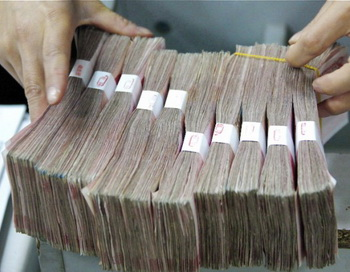 Журнал в Тайване недавно сообщил, что китайские военные чиновники переводят денежные средства с секретных банковских счетов материка в Тайвань. Фото: China FotoPress / Getty Images