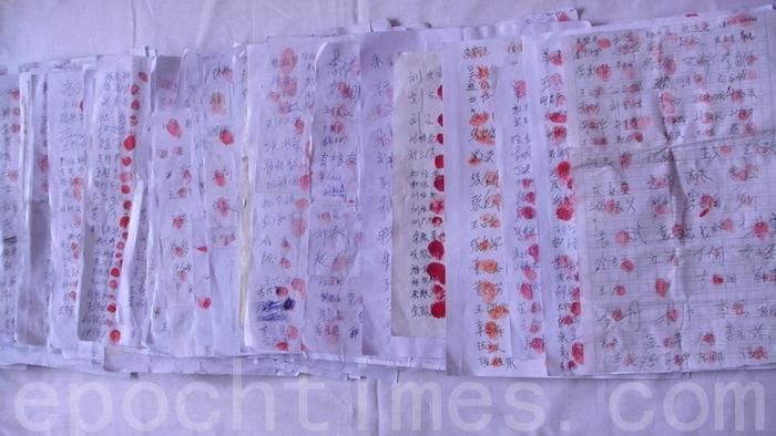Подписи в поддержку Фалуньгун. Фото: The Epoch Times
