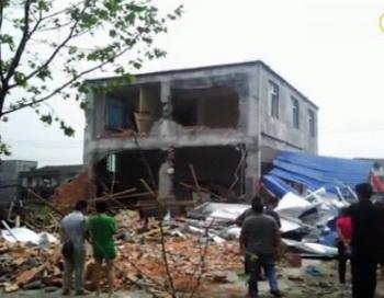 Разрушенное здание, определённое  местным секретарем КПК как «незаконная постройка». Фото: NTD Television Screenshot