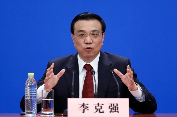 Ли Кэцян выступает на своей первой пресс-конференции в качестве премьера в Большом народном зале, 17 марта 2013 года, Пекин, Китай. Фото: Lintao Zhang/Getty Images