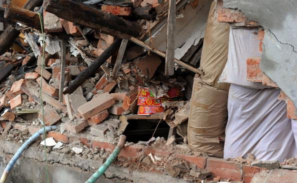 Фоторепортаж о взрыве в магазине фейерверков в Китае. Фото: ChinaFotoPress / Getty Images