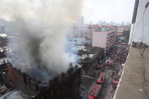 В результате пожара рухнули конструкции третьего этажа. .   Фото: ChinaFotoPress / Getty Images
