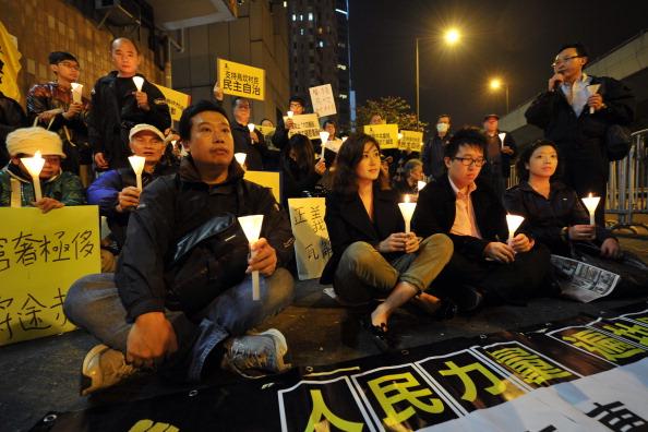 Протест в Гонконге в поддержку жителей Укан. Фото: STR/AFP/Getty