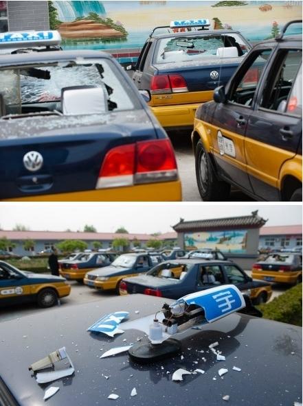 Разбитые автомобили такси. Пекин. Апрель 2012 год. Фото с epochtimes.com
