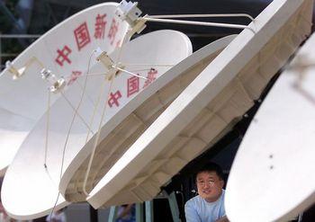 Китайцам запрещено смотреть иностранные спутниковые каналы. Фото: AFP