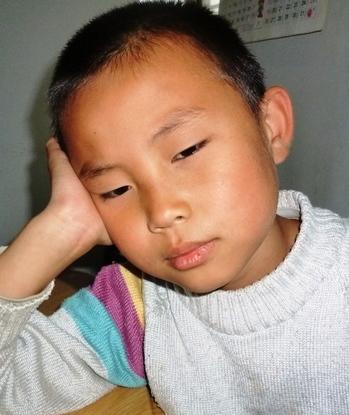 Хун Ян, 10-летний сын Тайнь Юйжун. Фото с epochtimes.com