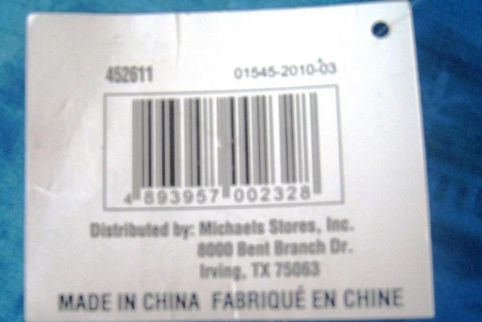 Этикетка с упаковки для мячиков на английском и частично на французском языке