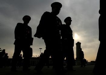 Высшие чиновники компартии Китая являются главным препятствием борьбы с коррупцией. Фото: MARK RALSTON/AFP/Getty Images