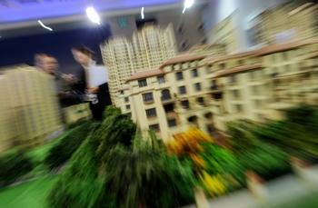 Правительству Китая выгодны завышенные цены на недвижимость. Фото: MARK RALSTON/AFP/Getty Images