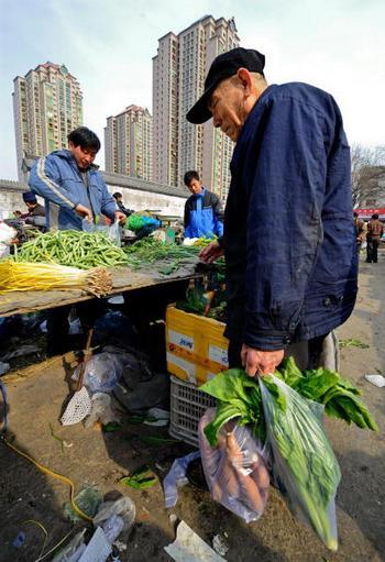 Производительность труда китайских крестьян в десятки раз ниже, чем в развитых странах. Фото: TEH ENG KOON/AFP/Getty Images