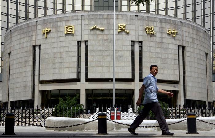 Официальные данные по китайскому ВВП снова под сомнением. Фото: AFP/TEH ENG KOON