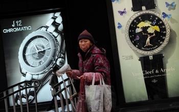 Многие китайские граждане практически не ощущают так называемых экономических успехов своей страны. Фото: MARK RALSTON/AFP/Getty Images