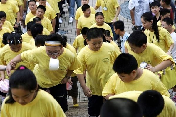 В Китае растёт количество людей с избыточным весом. Фото: AFP