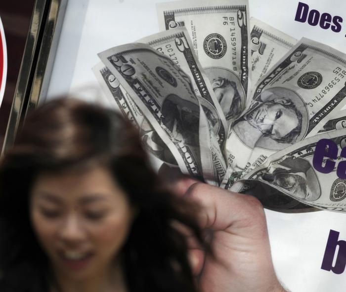 Китай продолжает скупать американские долги. Фото: ANTONY DICKSON/AFP/Getty Images