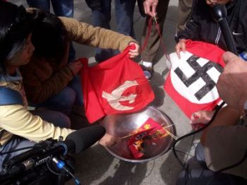 Компартия Китая, как и нацистская Германия, использует социальные и общественные организации для контроля над людьми. Фото: Democratic Voice