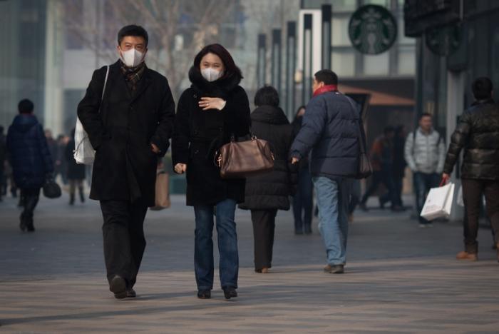 Пекин задыхается от смога. Фото: Ed Jones/AFP/Getty Images